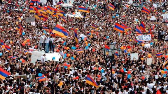 Pashinyan's supporters celebrate his victory Tuesday.