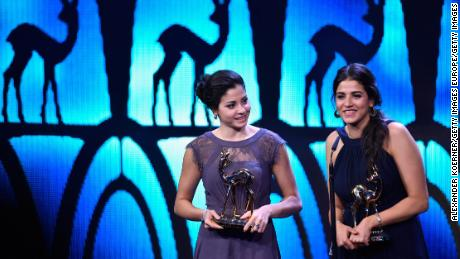 Yusra and Sara Mardini are seen on stage at the 2016 Bambi Awards. Sara has gone back to the the scene of their plight in Lesbos, in order to help others making similar journeys.