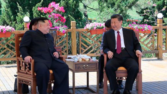 Chinese President Xi Jinping, right speaks to North Korean leader Kim Jong Un in Dalian in northeastern China.