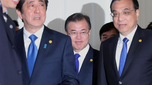 Japan's Shinzo Abe, from left, South Korea's Moon Jae-in and China's Li Keqiang meet in Tokyo.