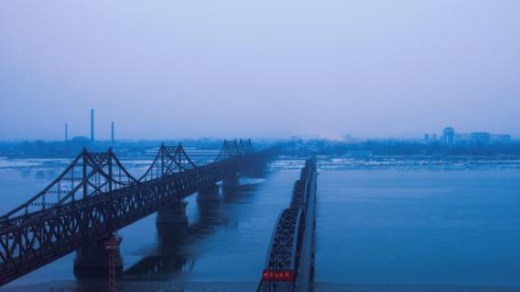 Fog is seen on the banks of the Yalu River in the Chinese border town of Dandong, opposite to the North Korean town of Sinuiju, on February 8, 2016.