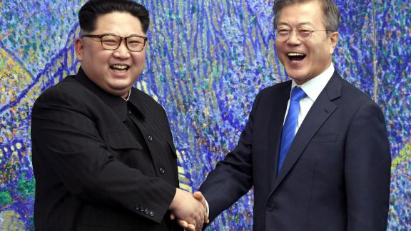 TOPSHOT - South Korea's President Moon Jae-in (R) shakes hands with North Korea's leader Kim Jong Un (L) during the Inter-Korean summit in the Peace House building on the southern side of the truce village of Panmunjom on April 27, 2018. - North Korean leader Kim Jong Un and the South's President Moon Jae-in sat down to a historic summit on April 27 after shaking hands over the Military Demarcation Line that divides their countries in a gesture laden with symbolism. (Photo by Korea Summit Press Pool / Korea Summit Press Pool / AFP)        (Photo credit should read KOREA SUMMIT PRESS POOL/AFP/Getty Images)