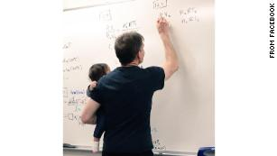That photo of a professor holding a student's baby while he taught? It's not the first time he's done that