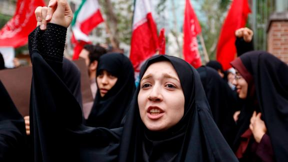 Iranian women chant slogans during an anti-US demonstration outside the former US embassy headquarters in the capital Tehran on May 9, 2018. - Iranians reacted with a mix of sadness, resignation and defiance on May 9 to US President Donald Trump