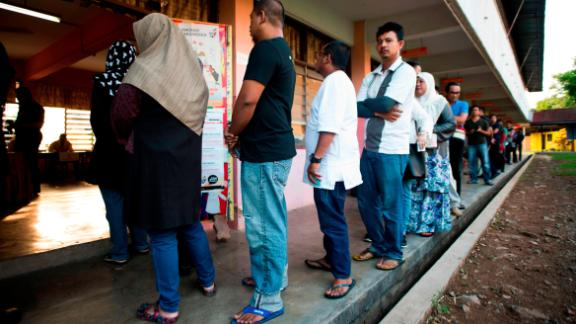Voters cast their ballots at a polling station during Malaysia