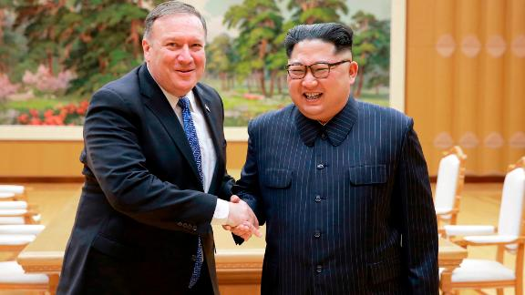 In this Wednesday,  photo provided on Thursday by the North Korean government, US Secretary of State Mike Pompeo shakes hands with North Korean leader Kim Jong Un.