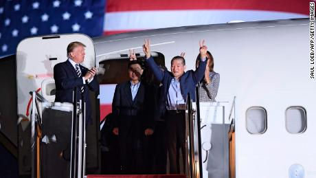 US President Donald Trump (L) applauds as US detainee Kim Dong-chul (2nd R) gestures upon his return with Kim Hak-song (C) and Tony Kim (behind) after they were freed by North Korea, at Joint Base Andrews in Maryland on May 10, 2018. - Trump was to greet the three US citizens released by North Korea at the air base near Washington early on May 10, underscoring a much needed diplomatic win and a stepping stone to a historic summit with Kim Jong Un. (Photo by SAUL LOEB / AFP)        (Photo credit should read SAUL LOEB/AFP/Getty Images)