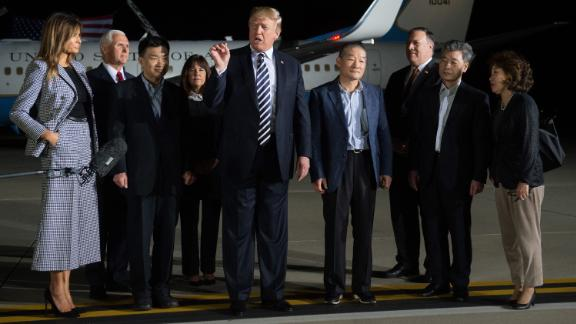 US President Donald Trump (C) speaks upon the arrival of US detainees Kim Dong-chul (4th R), Kim Hak-song (2nd R) and Tony Kim (3rd L) after they were freed by North Korea, at Joint Base Andrews in Maryland on May 10, 2018. - US President Donald Trump greeted the three US citizens released by North Korea at the air base near Washington early on May 10, underscoring a much needed diplomatic win and a stepping stone to a historic summit with Kim Jong Un. (Photo by SAUL LOEB / AFP)        (Photo credit should read SAUL LOEB/AFP/Getty Images)