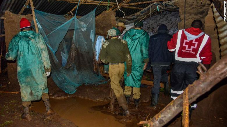 Volunteers search for survivors in a residential area after a dam bursts in northern Kenya on May 10, 2018.