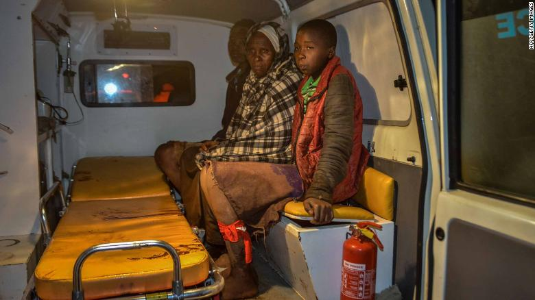 Local residents wait inside an ambulance. Lee Kinyanjui, the governor of Nakuru County, said food and other items have been donated to displaced families and a center was set up for families to report missing relatives.