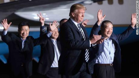 US President Donald Trump (2nd R) walks with US detainees Tony Kim (L), Kim Hak-song (2nd L) and Kim Dong-chul (R) upon their return after they were released by North Korea, at Joint Base Andrews in Maryland on May 10, 2018.