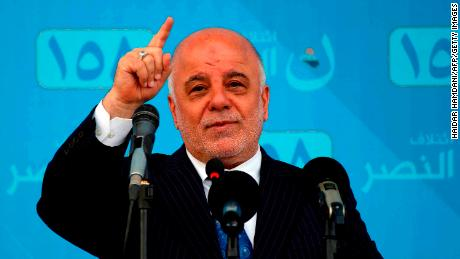 Iraqi Prime Minister Haider al-Abadi talks during a campaign rally in the holy city of Najaf  on May 3.