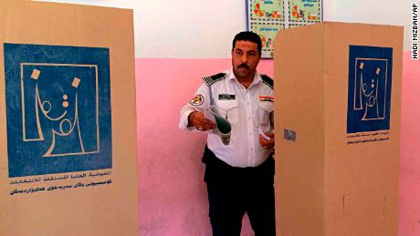 An Iraqi traffic policeman prepares to vote in Baghdad on May 10. Members of the security forces cast ballots before other voters.
