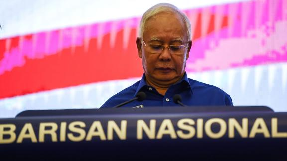 Outgoing Malaysian prime minister Najib Razak of the Barisan National party reacts as he addresses the media after his party lost the 14th general election in Kuala Lumpur on May 10.