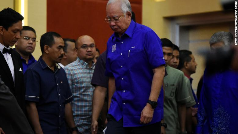 Outgoing Malaysian prime minister Najib Razak of the Barisan National party coalition arrives to address the media after his coalition's loss.