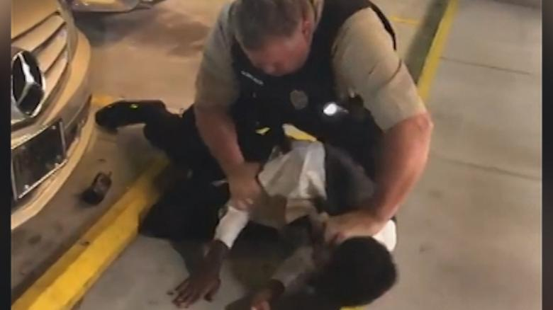 Video shows officer choking man