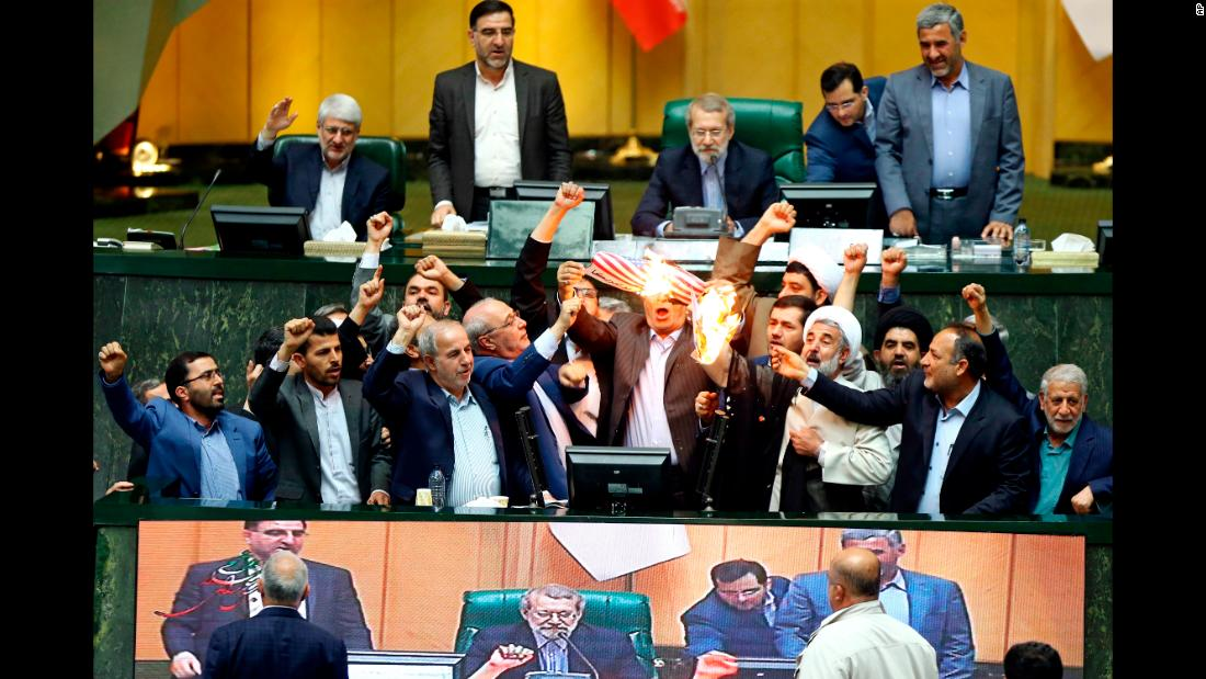 "Hardline Iranian lawmakers <a href=""https://www.cnn.com/2018/05/09/middleeast/iran-reacts-nuclear-deal-intl/index.html"" target=""_blank"">burn two pieces of papers in parliament</a> on Wednesday, May 9, after US President Donald Trump <a href=""https://www.cnn.com/2018/05/08/politics/donald-trump-iran-deal-announcement-decision/index.html"" target=""_blank"">withdrew from a nuclear deal</a> and restored sanctions against Iran. The two papers represented the US flag and the nuclear deal, and the lawmakers chanted ""death to America."""