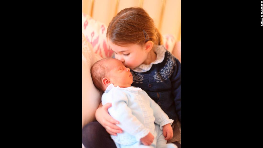 "Britain's Princess Charlotte, the 2-year-old daughter of Prince William and Duchess Catherine, kisses her new baby brother, Prince Louis, in this photo <a href=""https://www.cnn.com/2018/05/05/europe/prince-louis-princess-charlotte-photos-intl/index.html"" target=""_blank"">released by Kensington Palace</a> on Sunday, May 6."