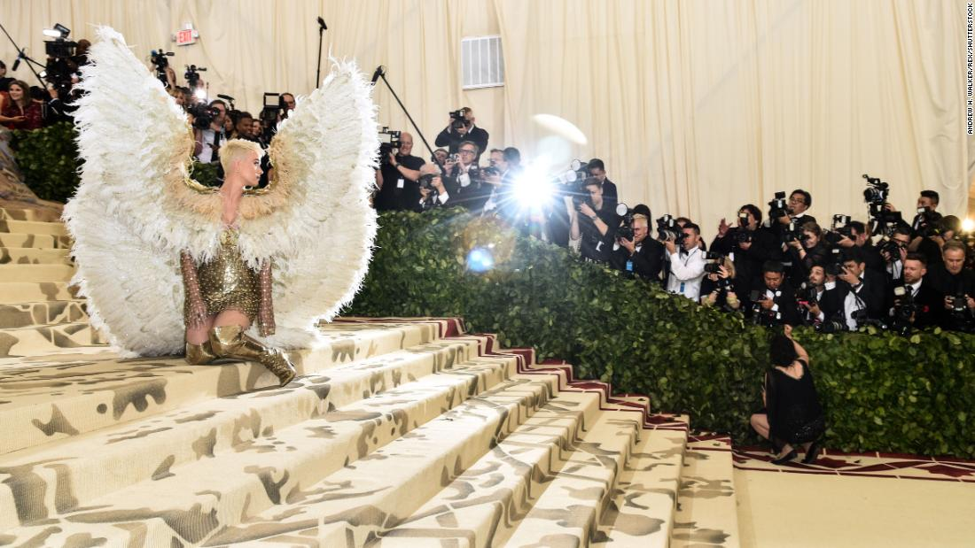 "Singer Katy Perry wears angel wings as she attends the Met Gala in New York on Monday, May 7. The annual event raises money for the Metropolitan Museum of Art's Costume Institute. This year's theme was ""Heavenly Bodies: Fashion and the Catholic Imagination."" <a href=""https://www.cnn.com/style/article/met-gala-red-carpet-2018/index.html"" target=""_blank"">See more photos of celebrities on the red carpet</a>"