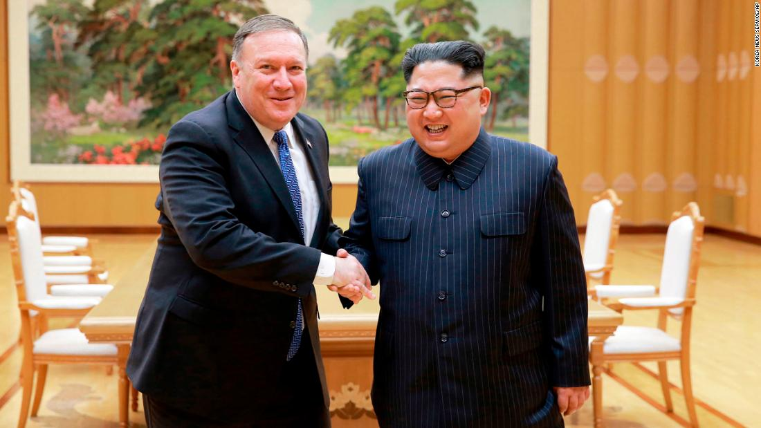 "US Secretary of State Mike Pompeo, left, shakes hands with North Korean Kim Jong Un in this photo taken Wednesday, May 9, and provided by the North Korean government. <a href=""https://www.cnn.com/2018/05/09/politics/mike-pompeo-north-korea-prisoners-tick-tock/index.html"" target=""_blank"">Pompeo was in the North Korean capital of Pyongyang</a> to discuss Kim's upcoming summit with US President Donald Trump."