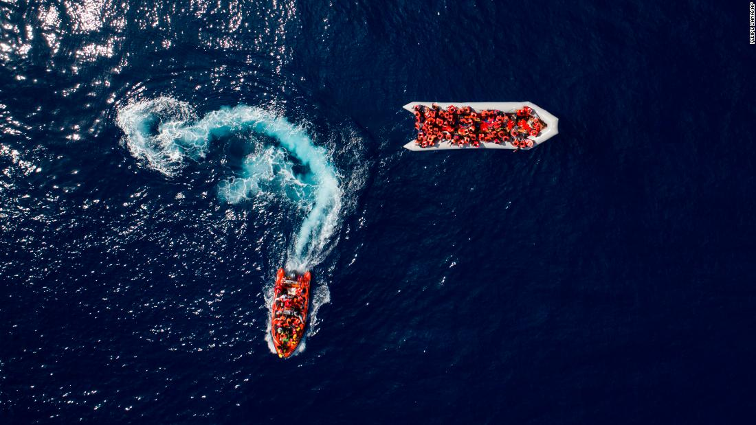 Migrants are rescued in the Mediterranean Sea, north of the Libyan coast, after trying to reach Europe aboard an overcrowded rubber boat on Sunday, May 6.