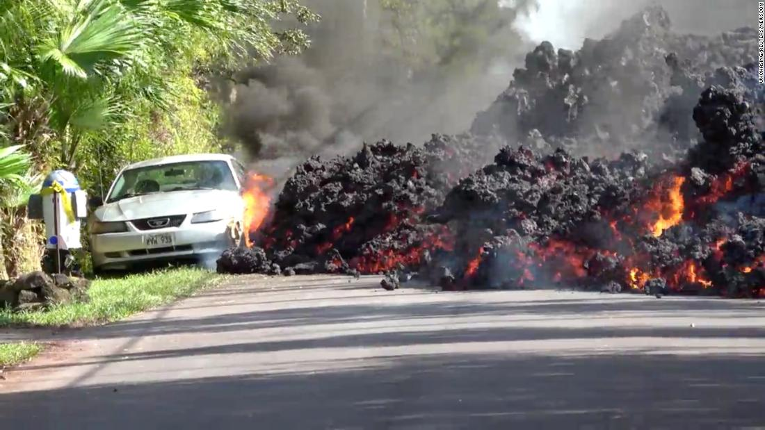 "Lava from the Kilauea volcano engulfs a sports car in Puna, Hawaii, on Sunday, May 6. A local resident <a href=""https://www.cnn.com/2018/05/07/us/hawaii-kilauea-volcano-eruption-time-lapse/index.html"" target=""_blank"">caught the incident on video.</a> The Kilauea volcano erupted last week, spewing molten rock and high levels of sulfur dioxide. Cracks emerged in the volcano's East Rift Zone -- an area of fissures miles away from the volcano's summit. Hundreds of people have been forced to evacuate their homes."