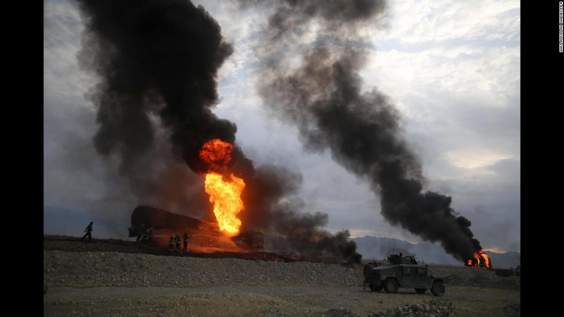 Firefighters work in Afghanistan's Nangarhar province after oil tankers were allegedly bombed by militants on Saturday, May 5.