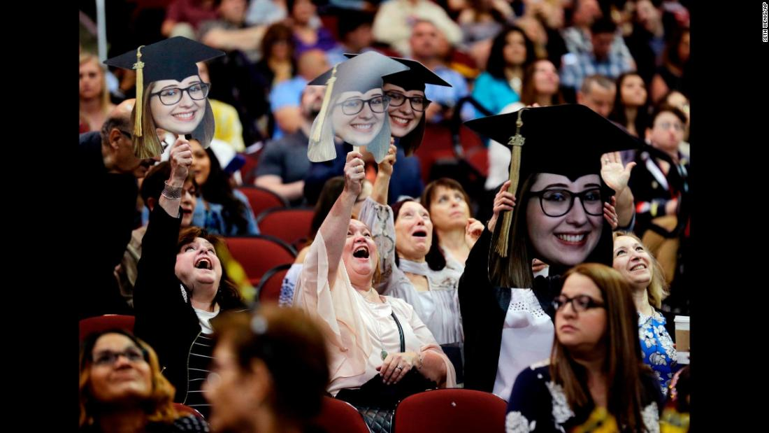 People show their support for a graduate of Ramapo College during a commencement ceremony in Newark, New Jersey, on Thursday, May 10.