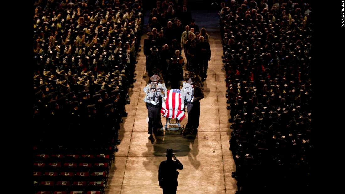 "Pallbearers walk alongside the casket of Cpl. Eugene Cole at the conclusion of the sheriff's deputy funeral service in Bangor, Maine, on Monday, May 7. Cole, 61, <a href=""https://www.cnn.com/2018/05/01/us/maine-police-officer-wife-facebook-post/index.html"" target=""_blank"">was fatally shot last month</a> in the line of duty."