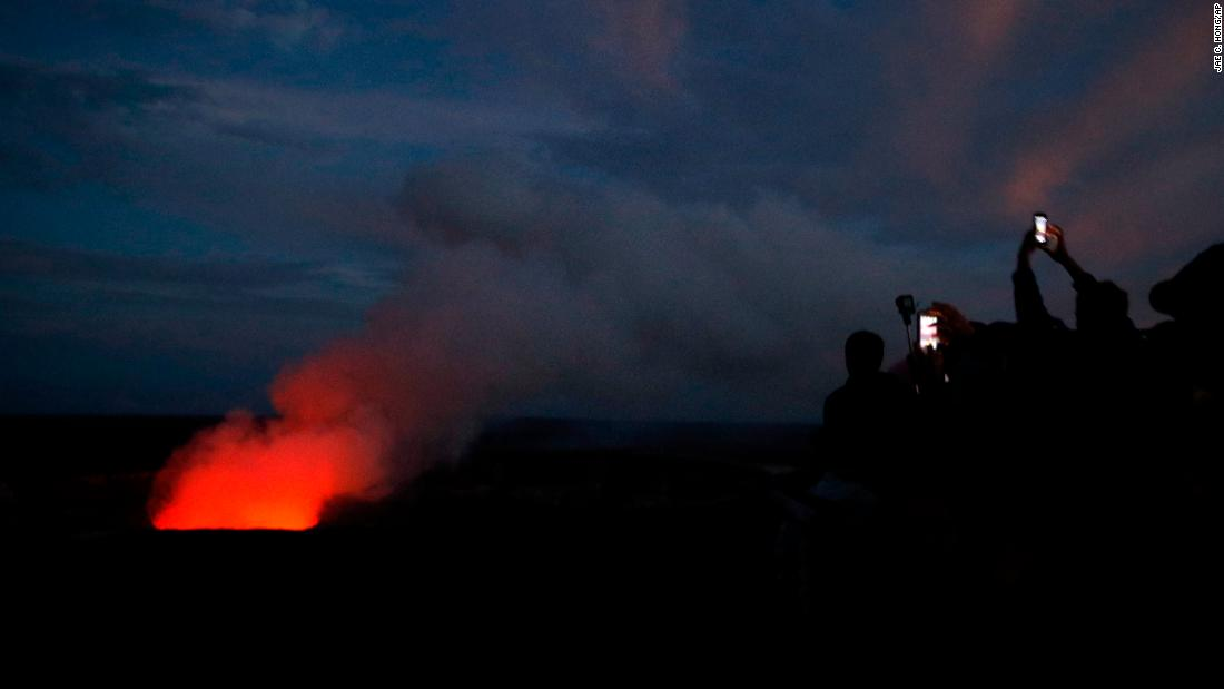"Visitors take pictures as the summit crater of the Kilauea volcano, which erupted last week, glows red on Wednesday, May 9. Now experts fear the volcano is at risk of <a href=""https://www.cnn.com/2018/05/10/us/hawaii-kilauea-volcano/index.html"" target=""_blank"">explosive eruptions</a> that could emit ""ballistic projectiles."" <a href=""http://www.cnn.com/2018/05/03/world/gallery/week-in-photos-0504/index.html"" target=""_blank"">See last week in 24 photos</a>"