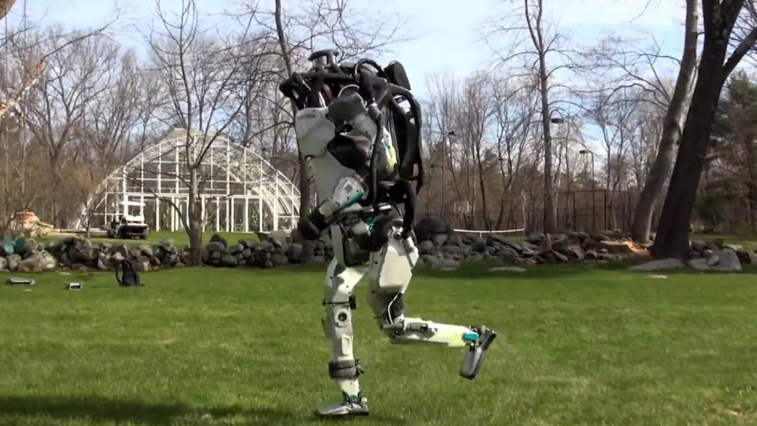 Humanoid robot runs through the park by itself