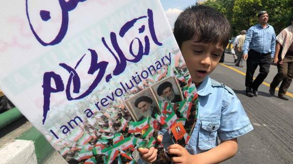 A young boy takes part in an demonstration in Tehran.