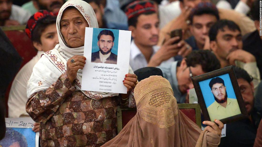 Pakistani demonstrators from the tribal Pashtun Protection Movement (PPM) hold pictures of missing family members during a rally in Peshawar.