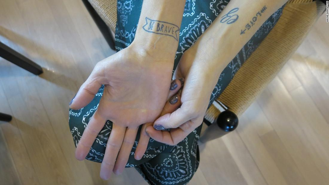 "During her cancer fight, Erika and her twin sister got matching tatoos with one message: ""Be brave."""
