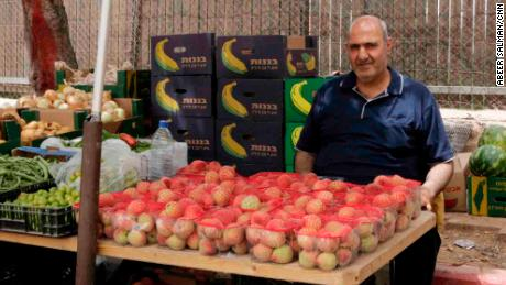 Khader Yousef, 53, works as a taxi driver and vegetable merchant at Bethlehem checkpoint.