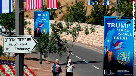 People walk near the compound of the US consulate in Jerusalem, which will host the new US embassy.