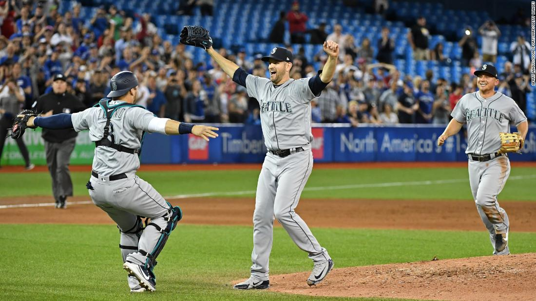 "Seattle pitcher James Paxton, center, celebrates with his teammates after <a href=""https://bleacherreport.com/articles/2775066-mariners-james-paxton-strikes-out-7-en-route-to-no-hitter-vs-blue-jays"" target=""_blank"">throwing a no-hitter</a> in Toronto on Tuesday, May 8. Paxton had seven strikeouts in the 5-0 victory."
