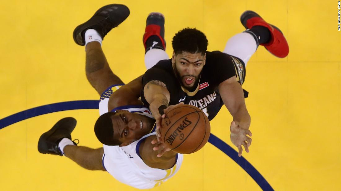 "Golden State's Kevon Looney, left, and New Orleans' Anthony Davis compete for a rebound during an NBA playoff game on Tuesday, May 8. Golden State <a href=""https://bleacherreport.com/articles/2775075-stephen-curry-warriors-beat-anthony-davis-pelicans-advance-to-wcf-vs-rockets"" target=""_blank"">won the series in five games</a> to advance to the Western Conference Finals."
