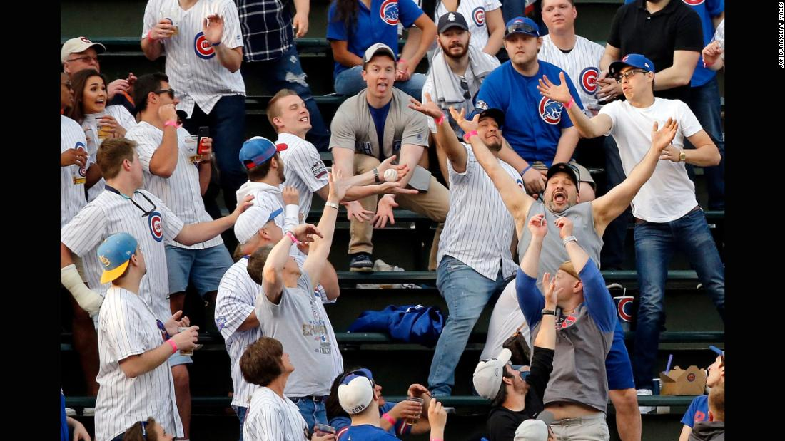 Fans at Chicago's Wrigley Field try to catch a home-run ball hit by Miami's Justin Bour on Tuesday, May 8.