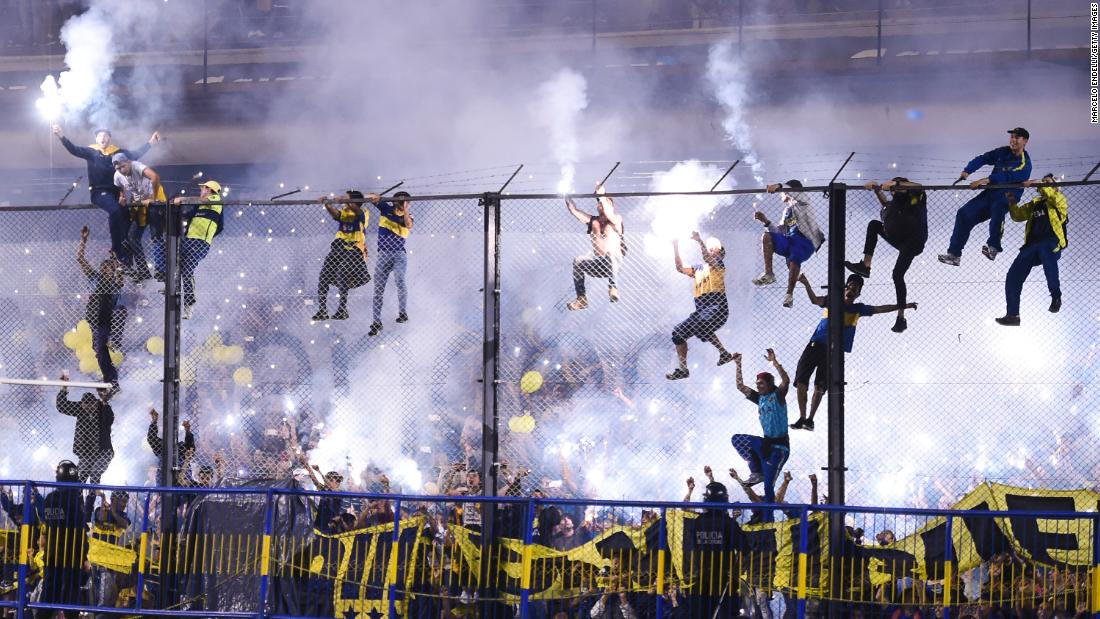 Fans of the the Argentine soccer club Boca Juniors celebrate after the team won the league on Wednesday, May 9.
