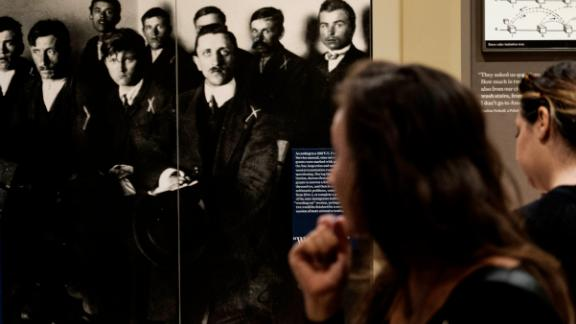 NEW YORK, NY - AUGUST 8: People walk through an exhibit with photographs of immigrants at the Ellis Island National Museum of Immigration on Ellis Island, August 8, 2017 in New York City. Immigration continues to be a hotly debated topic in the United States during the Trump administration. During a press briefing last week, Stephen Miller, President Donald Trump's senior policy advisor, discussed President Trump's support for a 'merit-based' immigration system. (Photo by Drew Angerer/Getty Images)