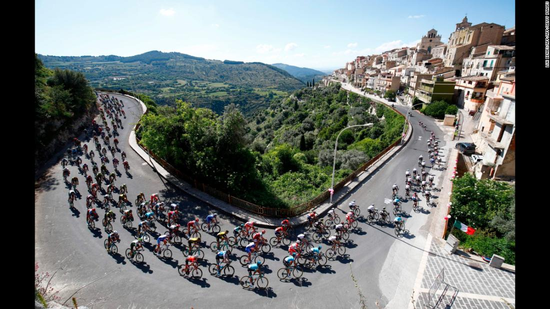 A pack of cyclists ride in Monterosso Almo, Italy, during the fourth stage of the Tour of Italy on Tuesday, May 8.