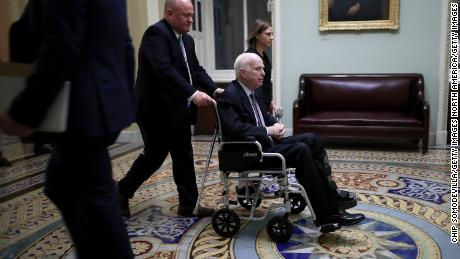 WASHINGTON, DC - NOVEMBER 30:  Sen. John McCain (R-AZ) moves through the U.S. Capitol in a wheelchair November 30, 2017 in Washington, DC. The Senate is debating the proposed GOP tax reform bill and hopes to pass it before the end of the week.  (Photo by Chip Somodevilla/Getty Images)