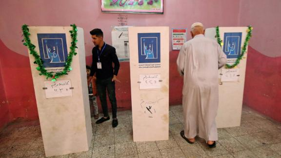 An Iraqi man walks toward a voting booth at a polling station in the southern city of Basra on May 12, 2018.