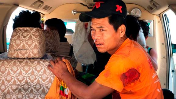 An injured man sits inside a vehicle on May 12, 2018, in Muse, northern Shan State, Myanmar, where officials say an ethnic rebel group launched an attack.