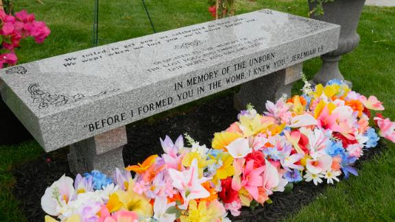 """A bench was """"dedicated to the memory of the lost eggs and embryos of 2018"""" at the Woodvale Union Cemetery."""