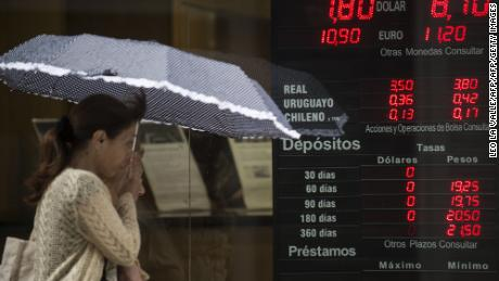 "The board of an exchange house in downtown Buenos Aires reads the rate of 7.80 argentine pesos to one dollar, sale rate and 8.10 to buy, on January 24, 2014. Argentina on Friday lifted restrictions in place since 2011 that limited the purchase of foreign currency, a day after the peso suffered its worst single-day dive since the 2002 financial crisis. The government has decided ""to authorize the purchase of dollars for holding or savings,"" said Jorge Capitanich, President Cristina Kirchner's cabinet chief. The restrictions had always been temporary and had served their purpose, said Capitanich. He added that, at a rate of 8.01 pesos to the dollar, the peso ""has reached a level acceptable to the objectives of economic policy convergence."" The move came with the peso in free fall, plunging more than 11 percent against the dollar on Thursday.        (Photo credit should read LEO LA VALLE/AFP/Getty Images)"