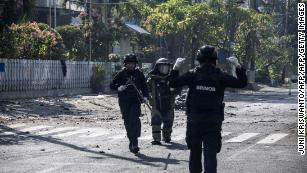 Indonesian Squad Members Examine The Site Following A Ing Outside Church In Surabaya Early Sunday