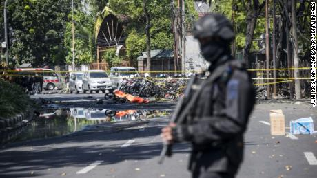 Family of suicide bombers attacks 3 churches in Indonesia, killing 7, police say