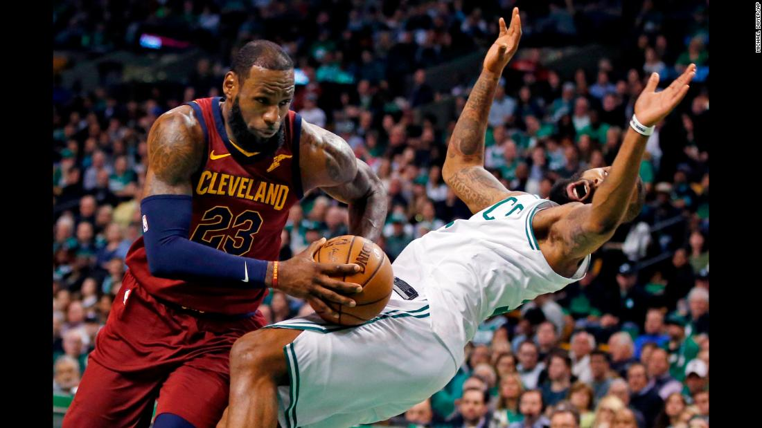 Cleveland Cavaliers forward LeBron James drives against the defense of Boston Celtics forward Marcus Morris during the first quarter of Game 1 of the NBA basketball Eastern Conference Finals on Sunday, May 13, in Boston.